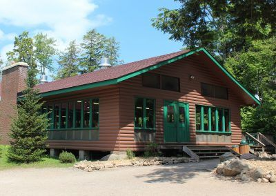 An image of the exterior of the Boyes Lodge Dining Hall at the Wenonah Outdoor Education Centre.