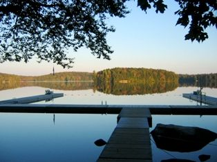 An image of the swim docks on Clear Lake at the Wenonah Outdoor Education Centre in Muskoka Ontario
