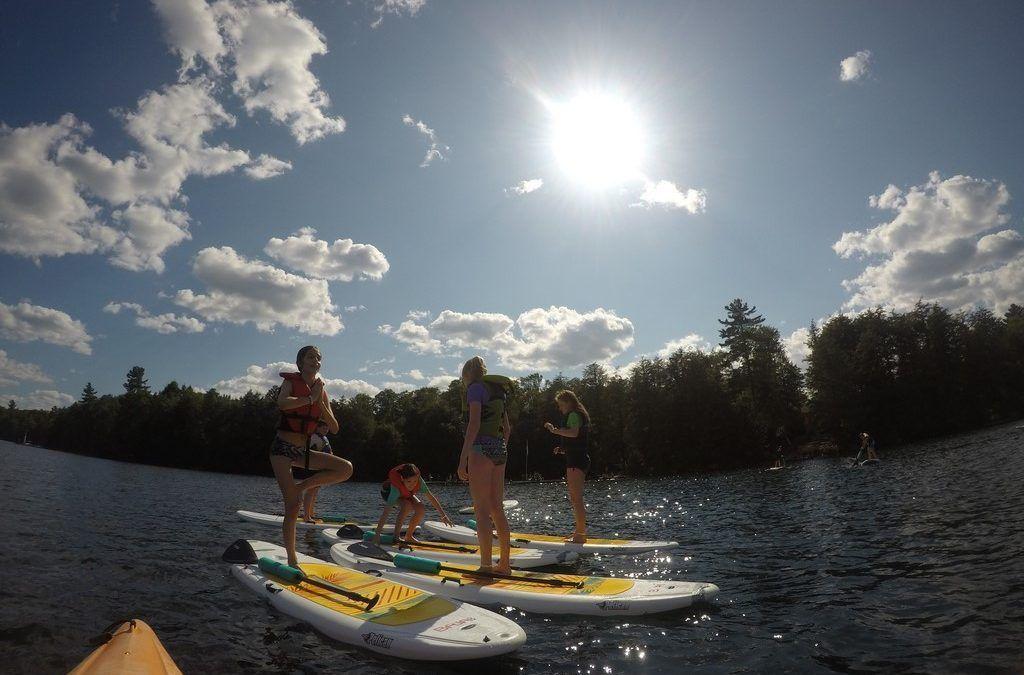 An image of paddleboarding at Camp Wenonah in Muskoka Ontario.