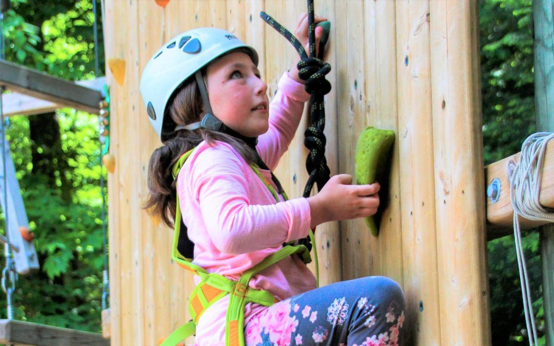 An image of a Camp Wenonah camper on the climbing wall.