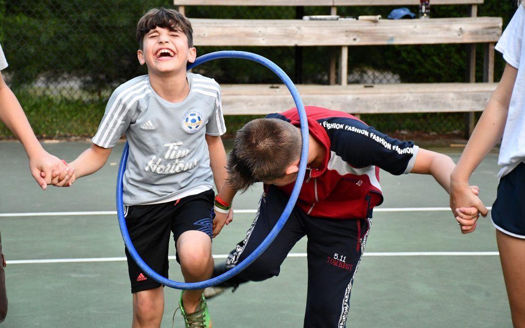 An image of kids at Camp Wenonah enjoying a summer camp activity.